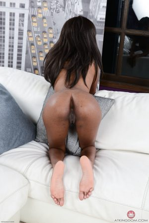 Skinny ebony Chanel Skye shows off her tiny tits and stretches her hole