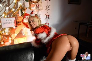 Cute blonde teen shows her tits and ass in white stockings at Xmas