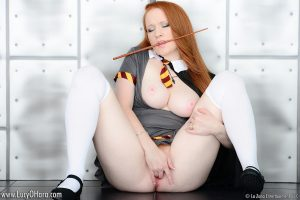 Pale redhead Lucy OHara plungers her fingers into her pussy on kitchen floor