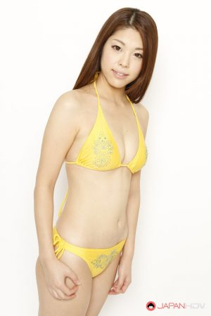 Young Japanese redhead models a yellow bikini in a safe for shoot