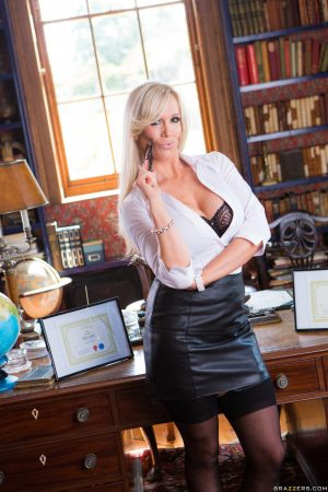 Stunning blonde cougar Rebecca More strips to lacy lingerie and poses at work