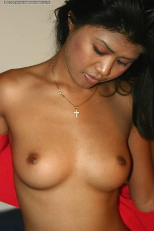 Asian chick Asia doffs a halter top and thong for her first nudes
