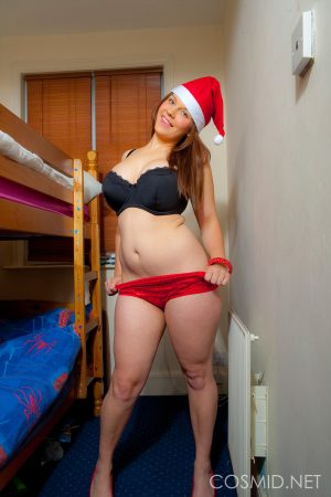 Chubby amateur Hannah Sharp releases her huge tits from Christmas clothing