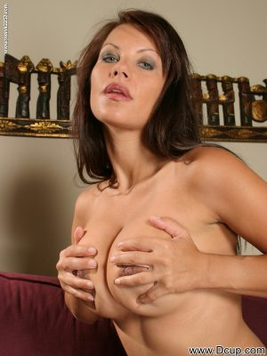 Solo model Kira licks a nipples after setting her nice tits free