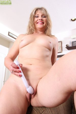 Mature woman Rebecca Hill masturbating with sex toy after undressing
