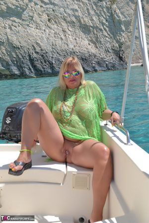 Beefy big Nude Chrissy pilots her boat naked to sun her round plump tits