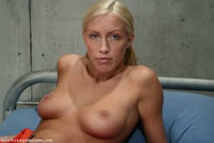 Naughty blonde inmate Cassie gets caught by prison guard masturbating in cell