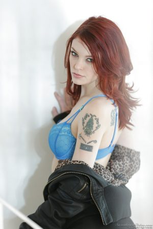 Pale redhead beauty Bree Daniels showing off her gorgeous natural tits