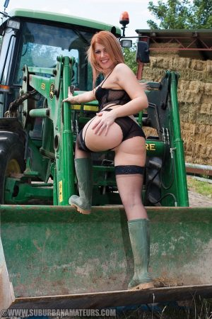 Naughty farmer Lara Lee masturbates in her hot lingerie & boots on the tractor
