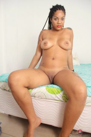 Exotic ebony Carina revealing her curvaceous tattooed body in a solo