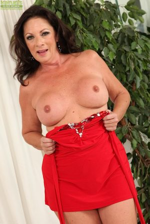 Hot mature Margo Sullivan lifts her tight skirt before showing her naked pussy