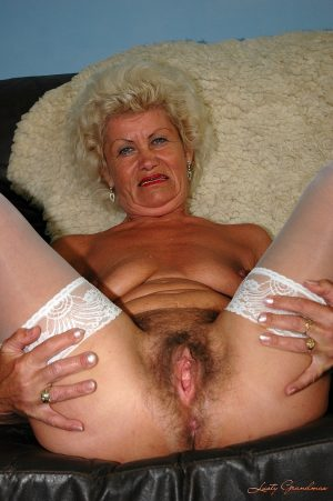 Curly haired grandma in stockings Effie gets her face and mature snatch fucked