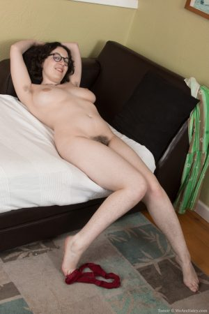Brunette amateur in glasses Tamar shows her big tits and bushy crotch
