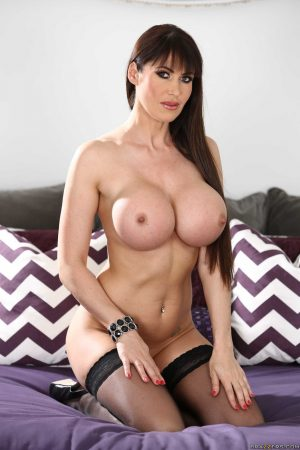Busty Belgian maid Eva Karera strips to her stockings & shows her sexy curves