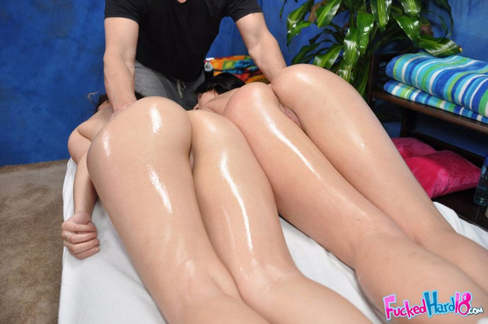 Young girls get all oiled up by a masseur before having a threesome
