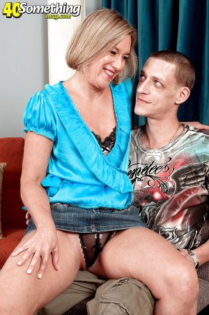 Blond mommy gets her tiny tits groped and her ass fucked by a younger guy