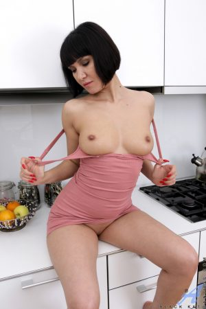 Short-haired MILF Black Kat plays with her soaking wet vagina in the kitchen