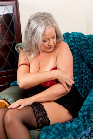 British granny April Thomas fingers herself while posing in her red lingerie