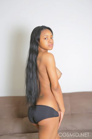 Ebony first timer uncovers her big natural boobs as she strips naked