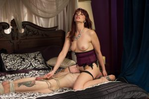 Wicked domme Maitresse Madeline Marlowe tastes a guy's balls after facesitting