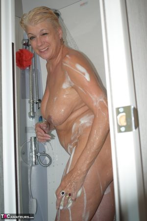 Mature blonde Dimonty gets caught washing her naked body while taking a shower
