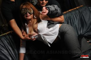 Stunning Japanese slave in collar & leash blindfolded & caged in BDSM play