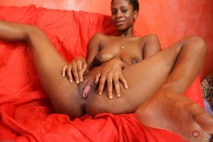 Leggy black female with short hair proudly displays her shaved vagina