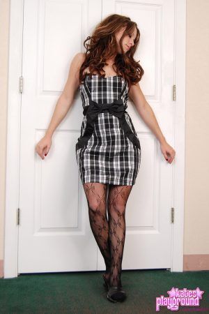 Amateur model Devon exposes stocking tops while modeling non nude in a dress