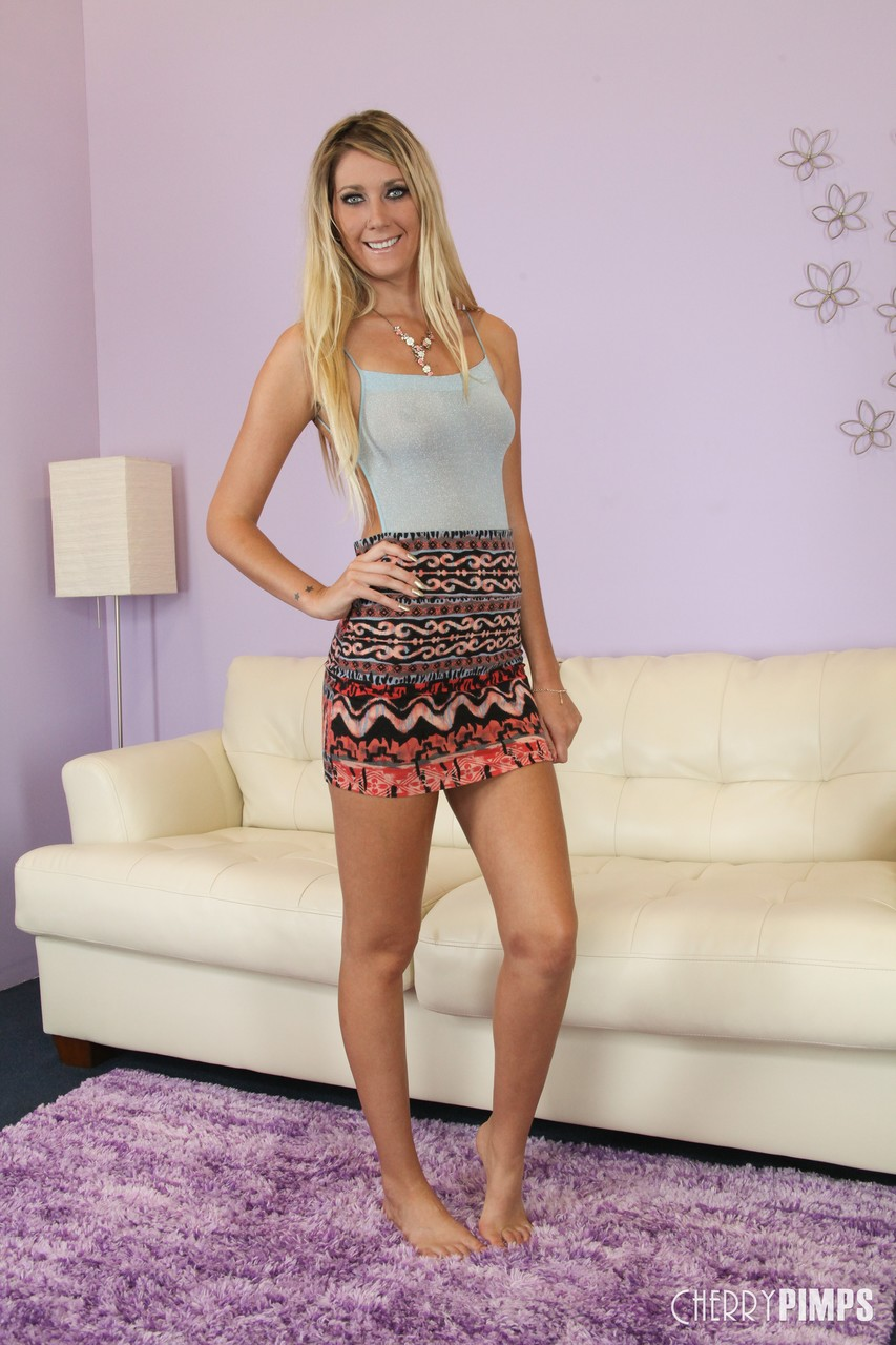 Hot blonde Alysha Rylee teasing with real tits & toying her muff on the carpet