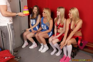 Clothed cheerleaders strip their coach and give him an incredible blowjob