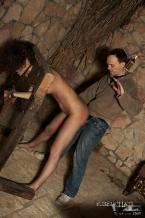 Alluring naked beauty Juliette Shyn shackled & fucked doggystyle in pillory