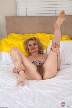 Horny granny with small tits Iabella Diana shows her hairy pussy in a solo