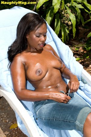Beautiful ebony coed Candie Lynn oiled & sunning her nice tits in the garden