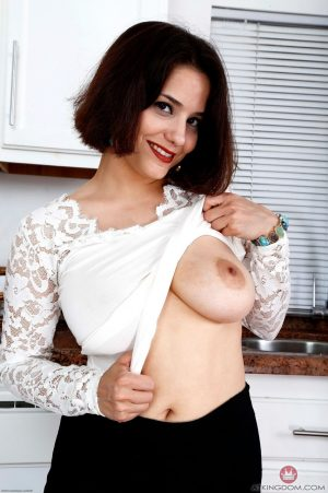 Brunette babe Jessica Pink exposes her hot breasts and shaved vagina