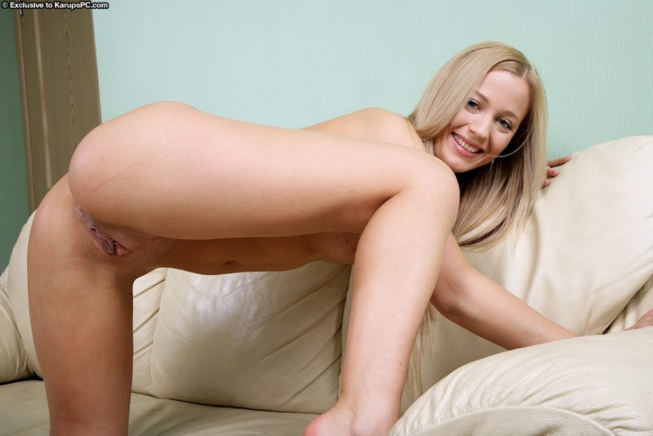 Lovely blonde amateur in jeans undressing and fingering her sweet pussy
