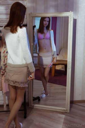 Pale redhead Juliett Lea strips afore a mirror before showing her pink pussy