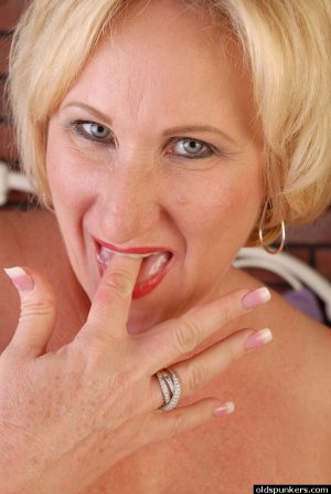 Mature blonde BBW eats cum from her hand after riding her lover's penis