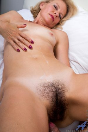 Blonde cougar Diana Gold is undressed and banged by her younger lover