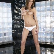 Beautiful brunette MILF Cassia Riley with natural tits spreads nude in heels