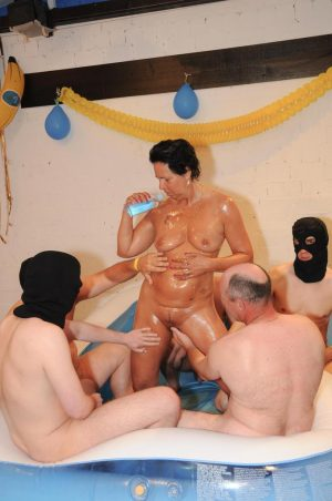 Mature lady brings her gangbang fantasies to life in blowup wading pool
