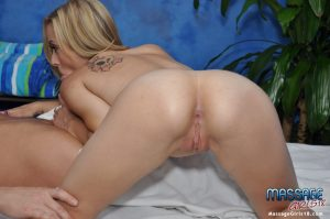 Young masseuse plants her tight pussy on a cock during a massage