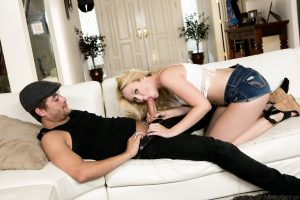 Sexy blonde Samantha Rone drips jizz from her chin after sex on a white couch