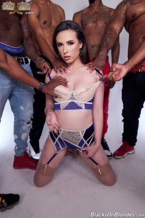 MILF Casey Calvert gets a cock in both her holes in an interracial gangbang