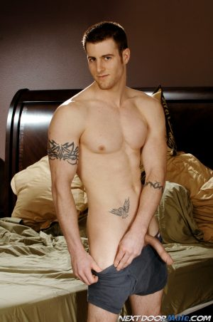 Gay amateur Ryan F shows his big stiff dick and poses in his bedroom