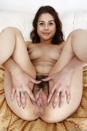 Brunette Penelope Reed stretches her ass cheeks and hairy twat before toying