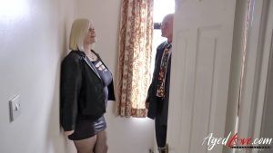 Blonde granny with amazing tits strips and gets fucked wearing stockings