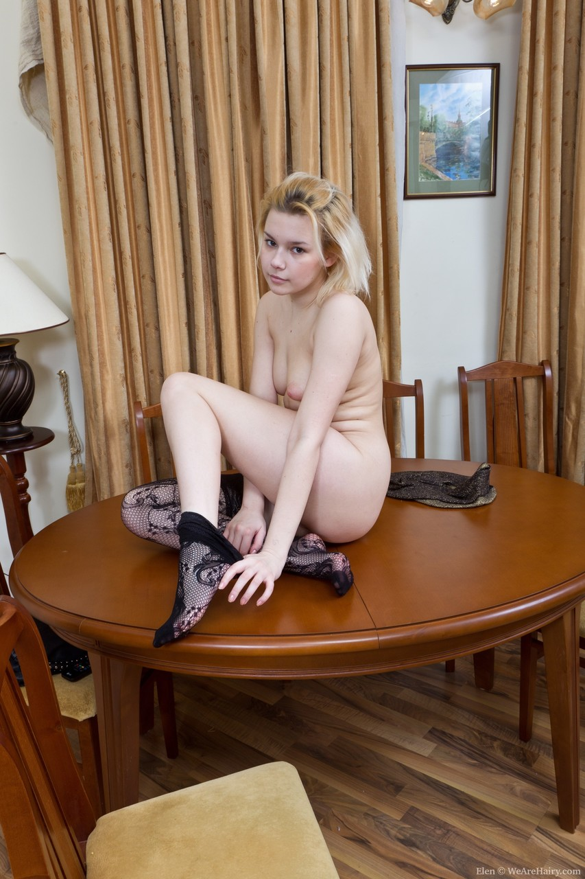 Sexy blonde Elen undresses & spreads her legs wide to show her hairy pussy