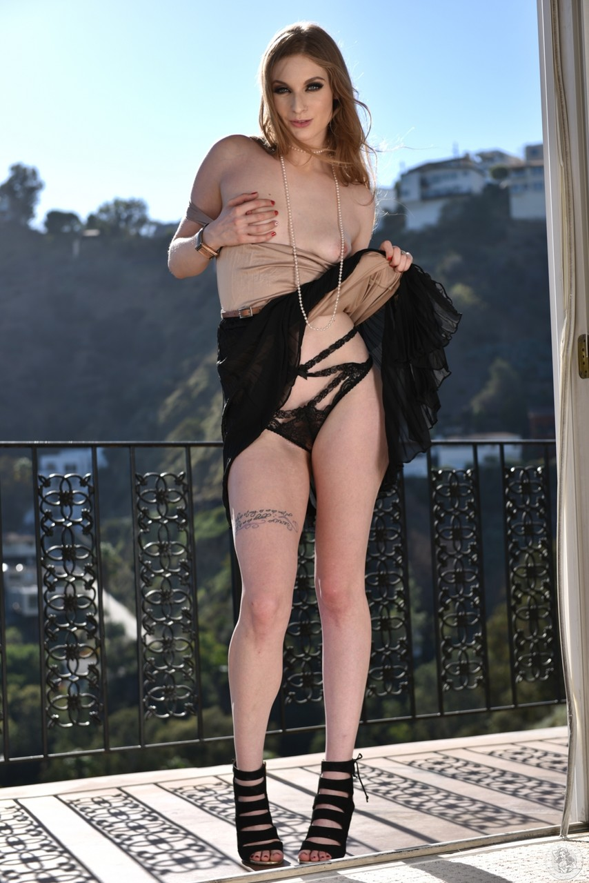 Hot and sexy brunette Ela Darling showing her perfectly shaped body outdoors