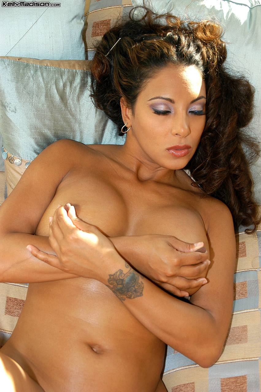 Brunette Latina with big tits Dee teases by fondling her big ass and vagina