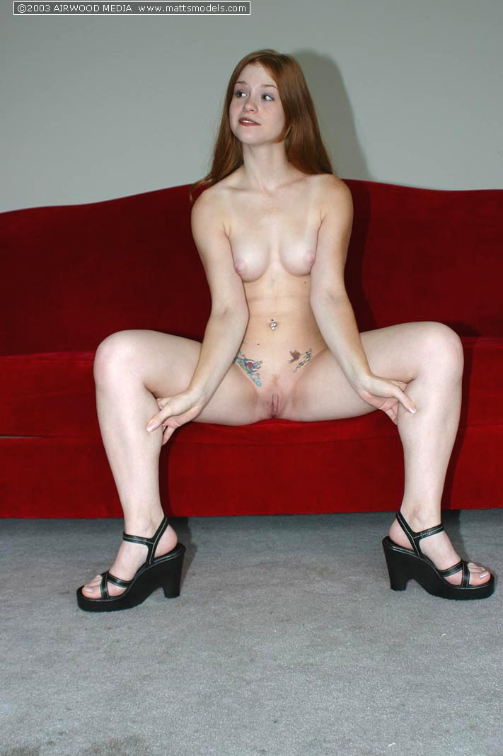 Young redhead with tight butt cheeks spreads her pink twat in solo action